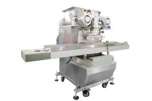Full-automatic mochi enrusting and tray arranging machine